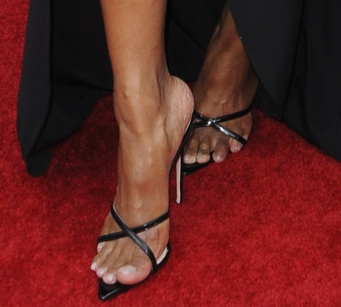 Ciara's feet in black pointy-toe sandals