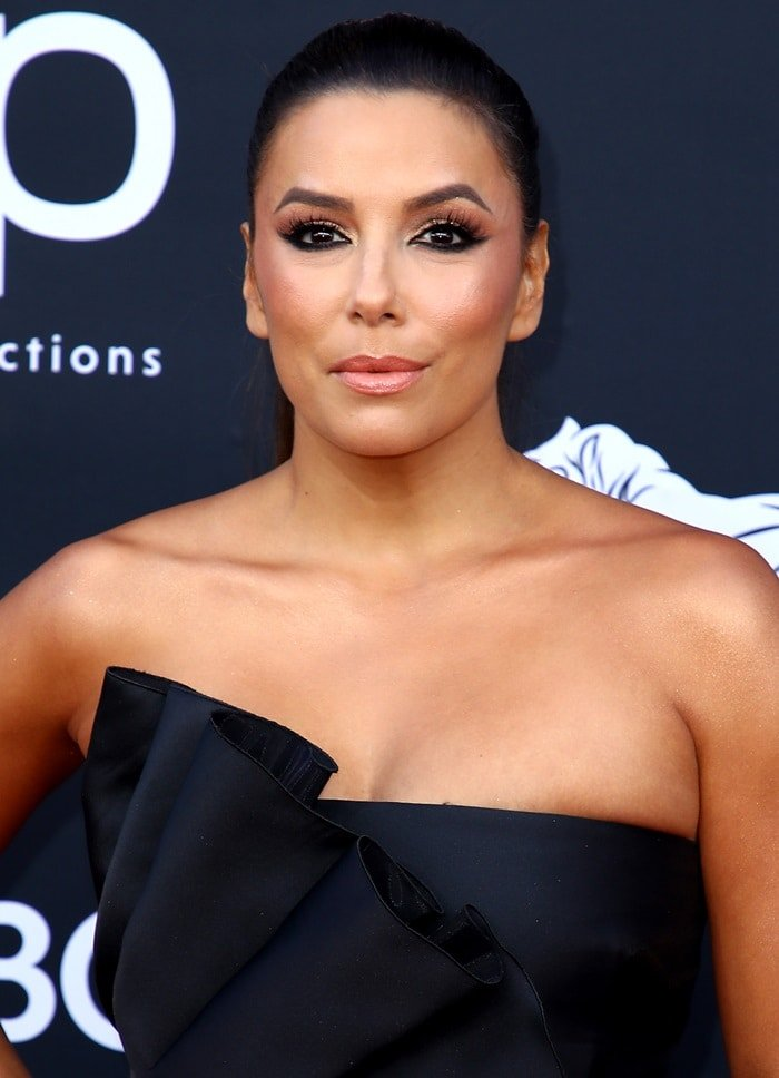 Eva Longoria squeezed her breasts into a black cocktail dress