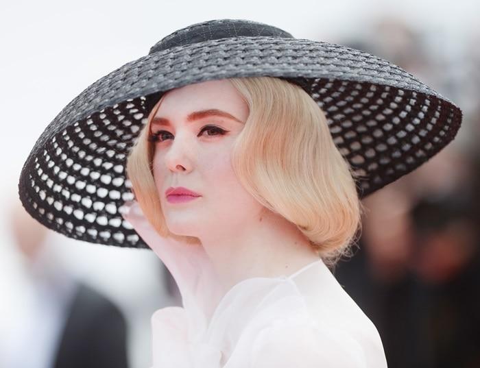 Elle Fanning's black wide-brim macramé hat