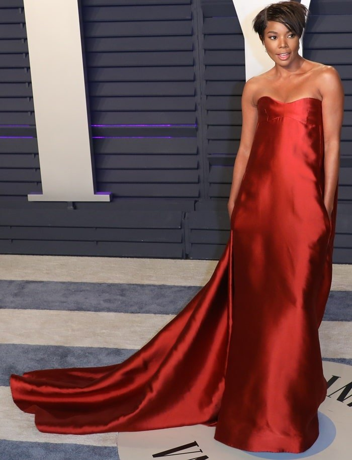 Gabrielle Union in a gorgeous red dress at the 2019 Vanity Fair Oscar Party