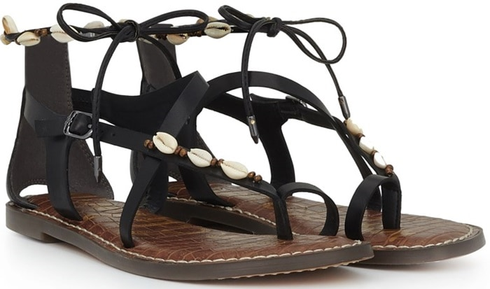 Add a touch of the tropics to your sun-inspired attire with lace-up leather sandals that flaunt strappy styling embellished with beads and shells