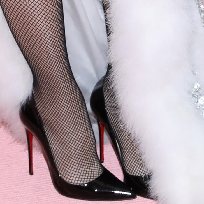 Gwen Stefani's hot feet in stockings and So Kate pumps by Christian Louboutin