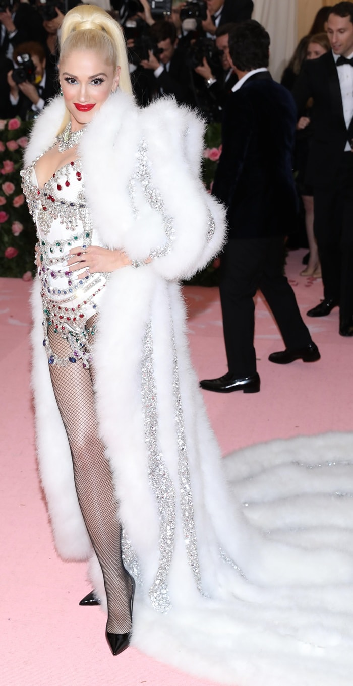 Gwen Stefani flaunted her legs in fishnet stockings on the pink carpet at the 2019 Met Gala