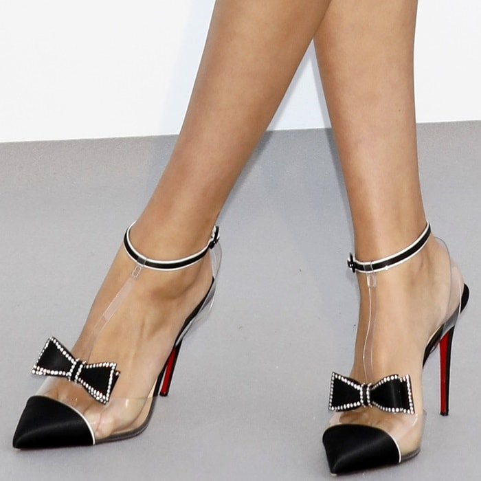 Hailey Clauson's hot feet in Christian Louboutin Naked Bow pumps