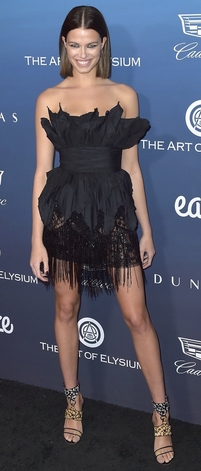 Hailey Clauson's long legs at the Art of Elysium's 12th Annual Celebration Heaven