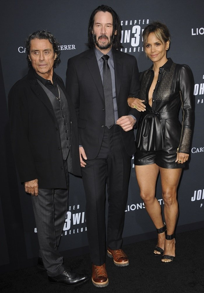 Ian McShane, Keanu Reeves, and Halle Berry on the black carpet