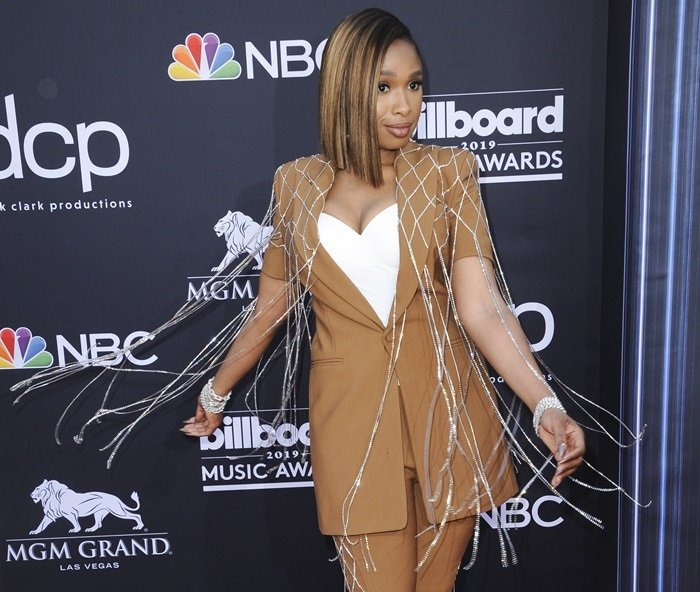 Jennifer Hudson's blazer dress features a crystal-embellished netting overlay with fringed hem