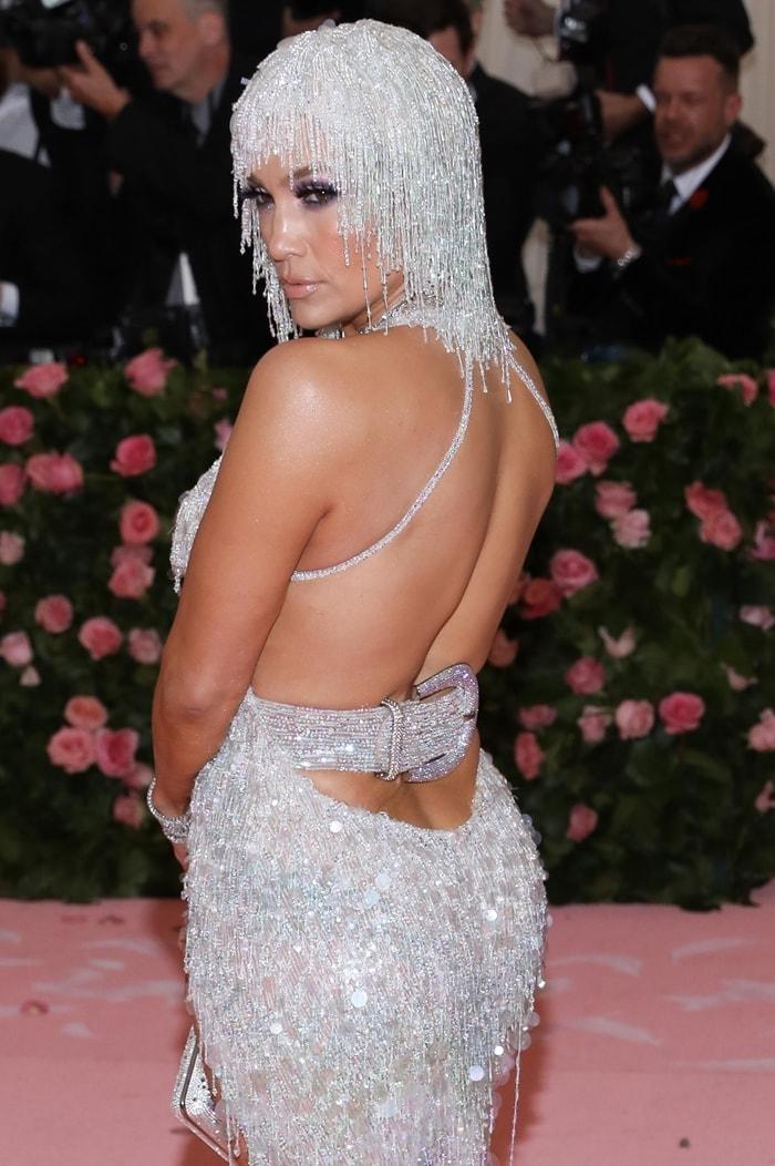 Jennifer Lopez in a plunging silver fringe dress