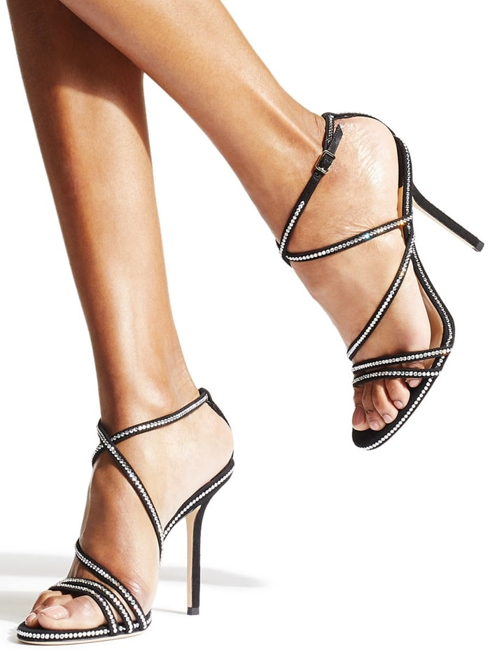 Jimmy Choo's Dudette sandals are decorated with tiny crystals at the straps, edges and heels, adding just the right amount of sparkle to the classic shoe