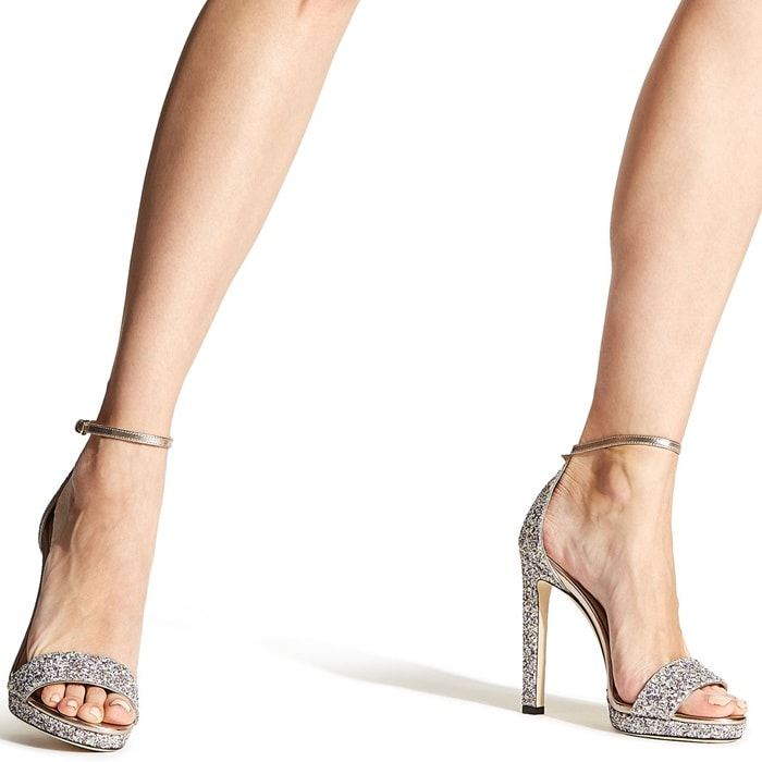 A slim platform and lofty stiletto heel add leg-lengthening lift to a minimalist Italian sandal