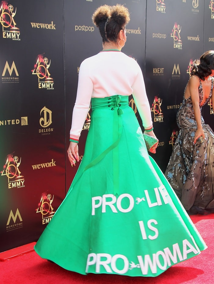 """Joy Villa's bright green skirt features the line """"Pro-life is pro-woman"""""""