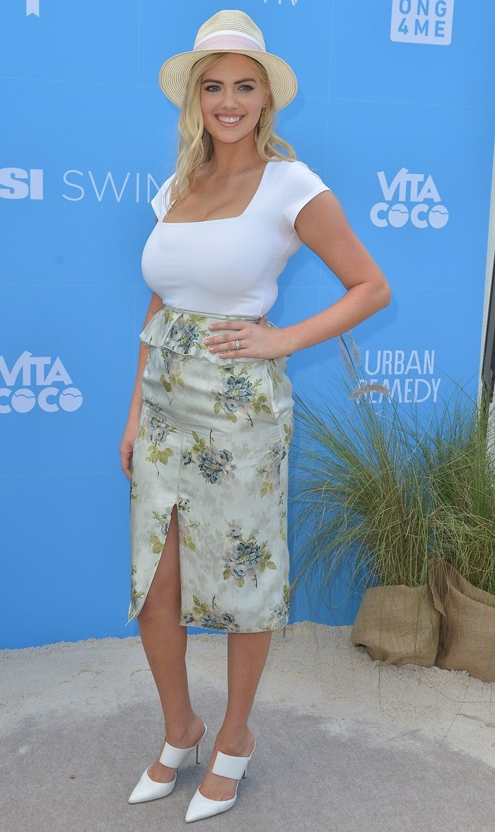 Kate Upton flashed her legs in a Sylvi ruffled floral-print silk-jacquard midi skirt