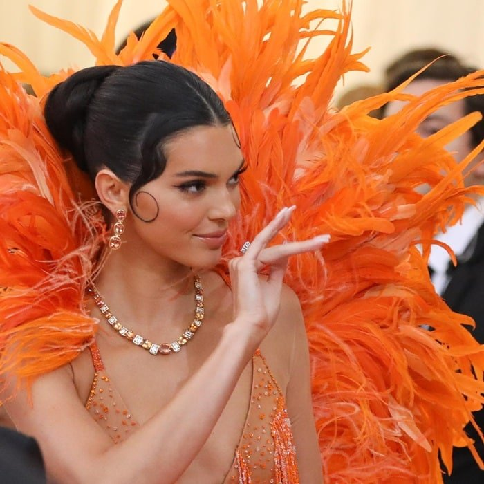 Kendall Jenner with slicked back hair and Tiffany & Co. jewels