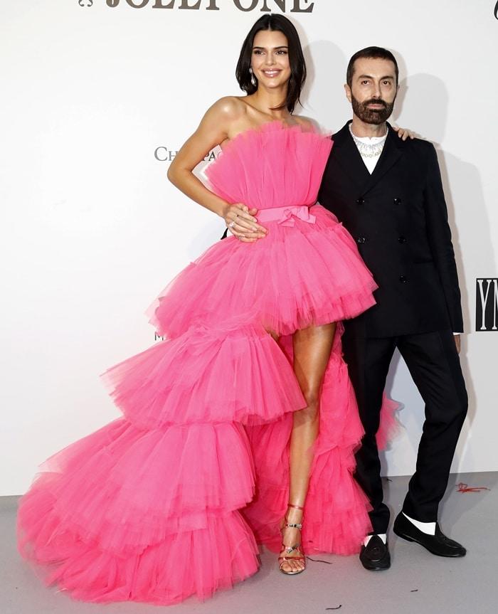 Kendall Jenner flaunted her slender legs while posing with Italian fashion designer Giambattista Valli