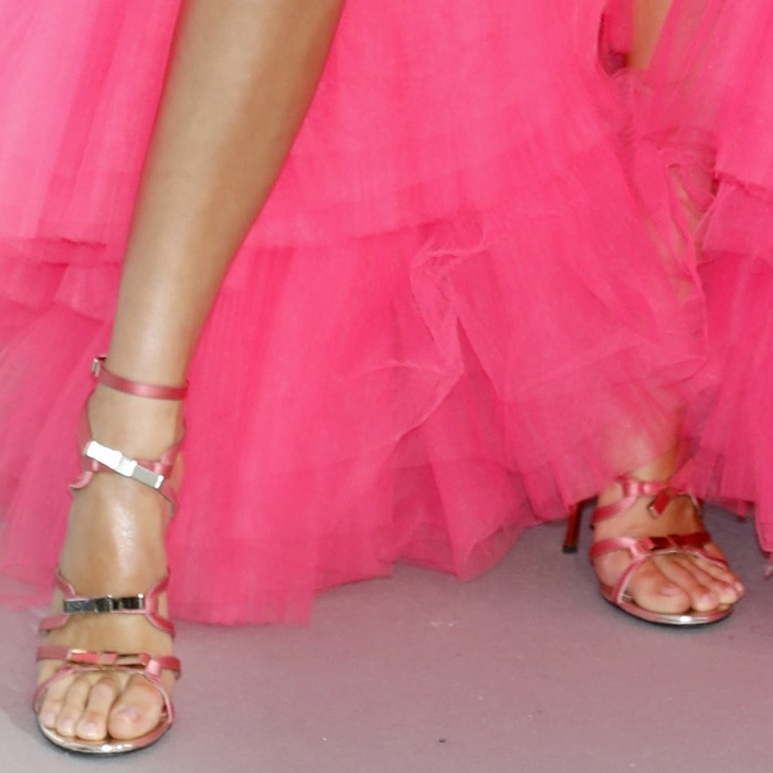 Kendall Jenner's feet in strappy stiletto sandals with metallic bow detailing