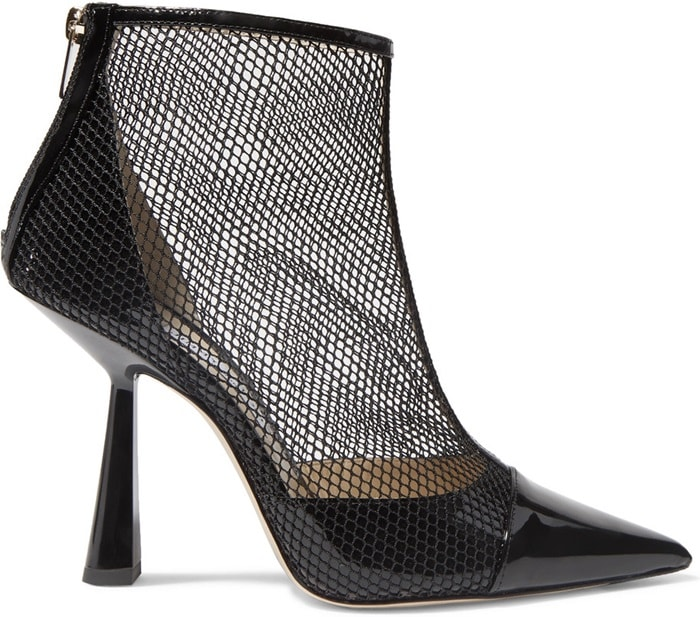 Crafted in Italy from glossy patent-leather, these 'Kix' ankle boots have flexible fishnet overlays that give the sleek point-toe silhouette a grunge vibe