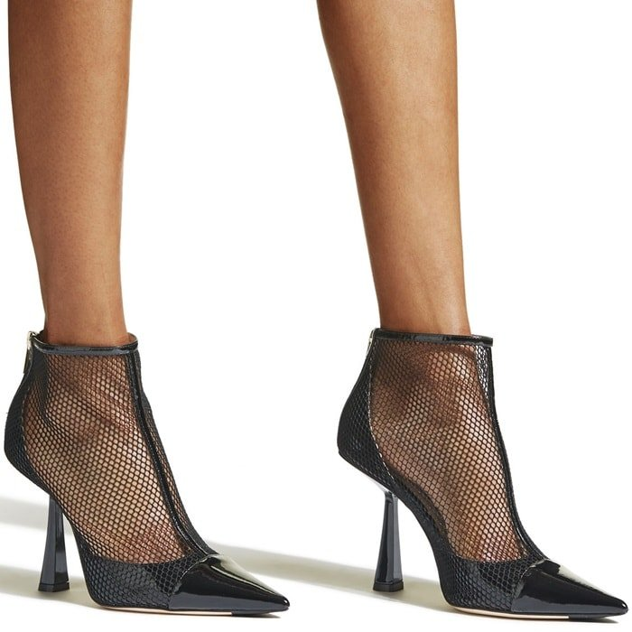 Fishnet mesh, a patent T-strap and flared heel make this pointy cap-toe pump look daringly provocative
