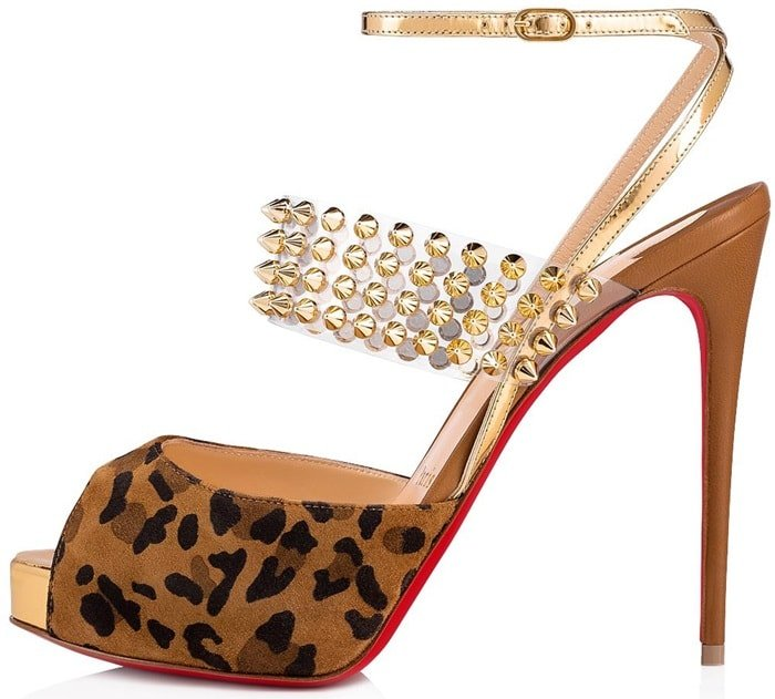 On the vamp, a wide PVC strap, designed like a necklace for the foot, houses four rows of spikes