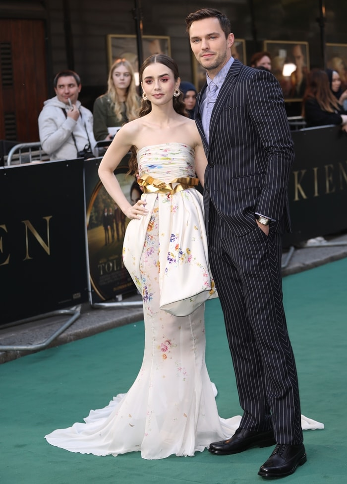 Lily Collins and Nicholas Hoult at the UK premiere of their new movie Tolkien at the Curzon Mayfair in London, England, on April 29, 2019