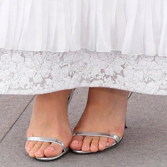 Margot Robbie's hot feet in Argento Specchio Reveal metallic sandals