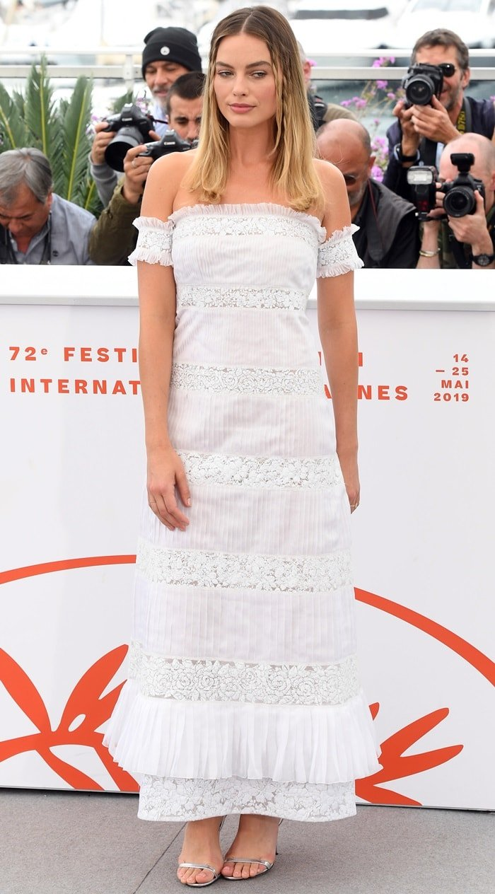 Margot Robbie in a white Chanel dress at the photo call for her anticipated film Once Upon A Time In Hollywood