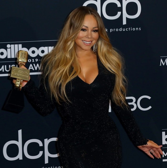 Mariah Carey flaunted her cleavage in a glittery black dress
