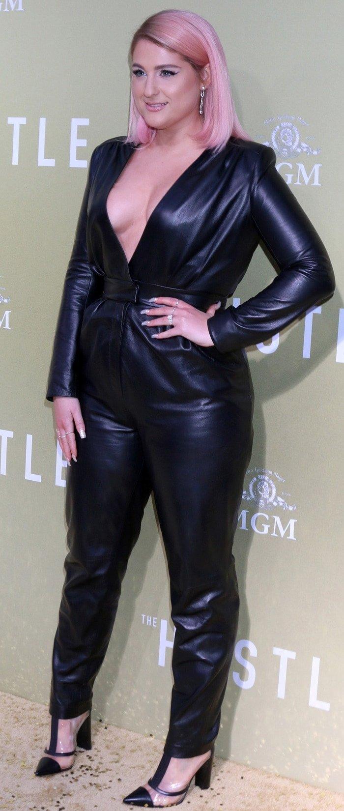 Meghan Trainor's jumpsuit features a revealing v-neck