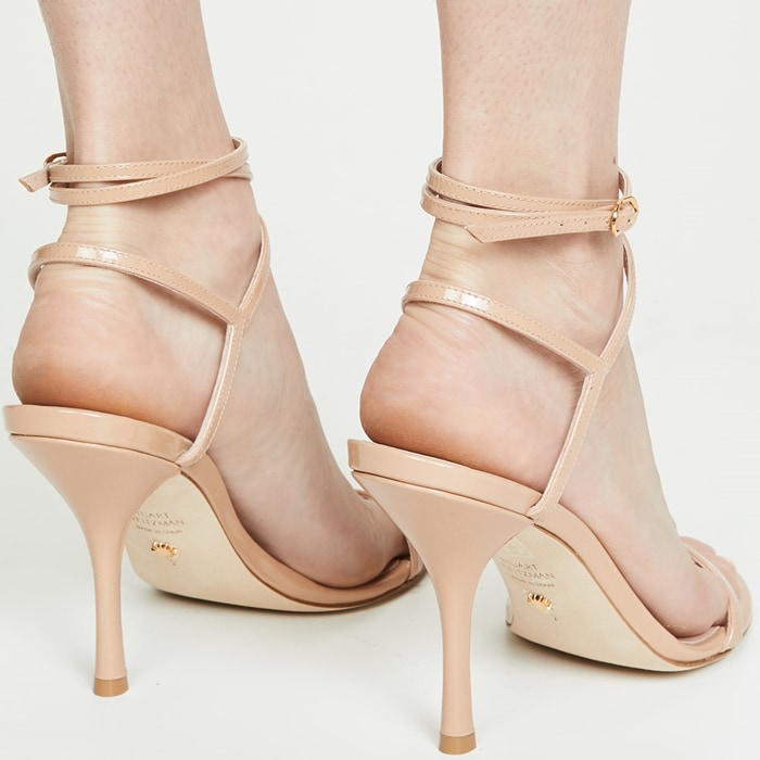 Stuart Weitzman's 'Merinda' sandals really will make your legs look longer thanks to their barely-there silhouette and 4-inch stiletto heel