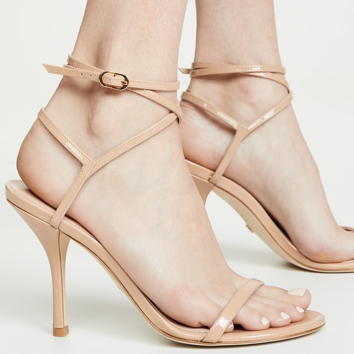 Slender straps cage the ankle and add fierceness to this upscale and elegant sandal that towers on a slender stiletto heel