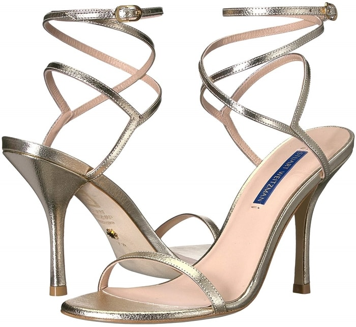 Accentuate your evening look in the Merinda sandals featuring a metallic or patent leather and a wraparound ankle strap