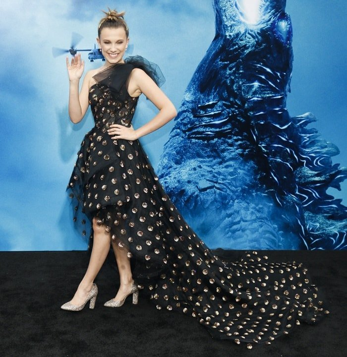 Millie Bobby Brown flaunted her legs in a Pierre Hardy Gena glitter block-heeled shoes