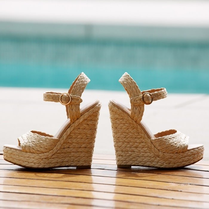 this raffia two-piece platform wedge sandal features an ankle strap buckle closure