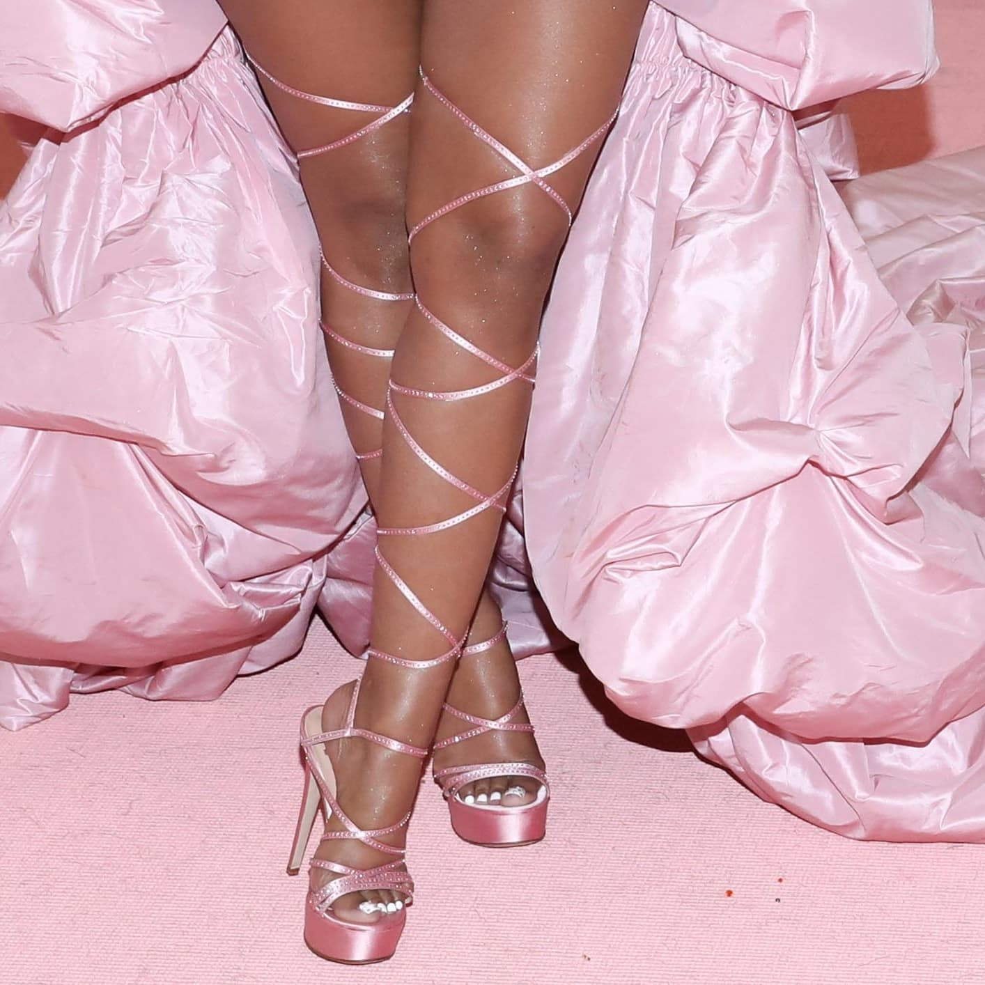 Nicki Minaj showed off her feet and legs in strappy sandals by Brother Vellies