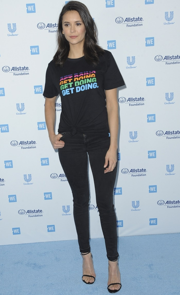 Nina Dobrev in skinny jeans and a Get Doing slogan t-shirt