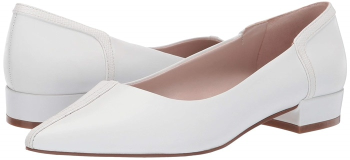 Contrast details highlight the sleek silhouette of a versatile skimmer flat with a classic pointy-toe vamp