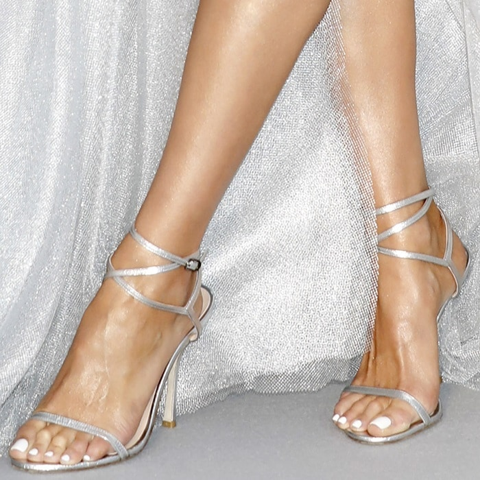 Olivia Culpo's hot feet in silver metallic leather Merinda sandals by Stuart Weitzman