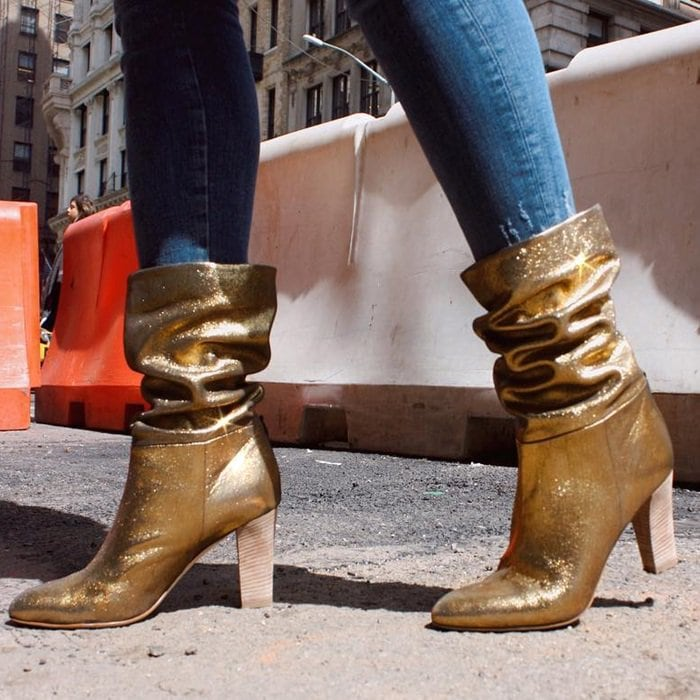 Get ready to stop traffic in these slouchy gold karat boots
