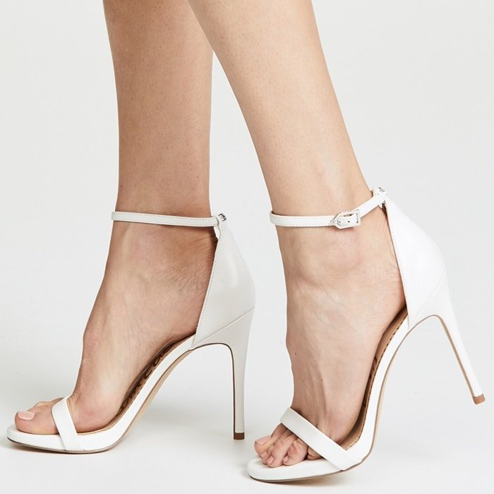 With a pared back silhouette and bright, white hue, these pumps are a sleek and sexy option that look amazing no matter what you pair them with