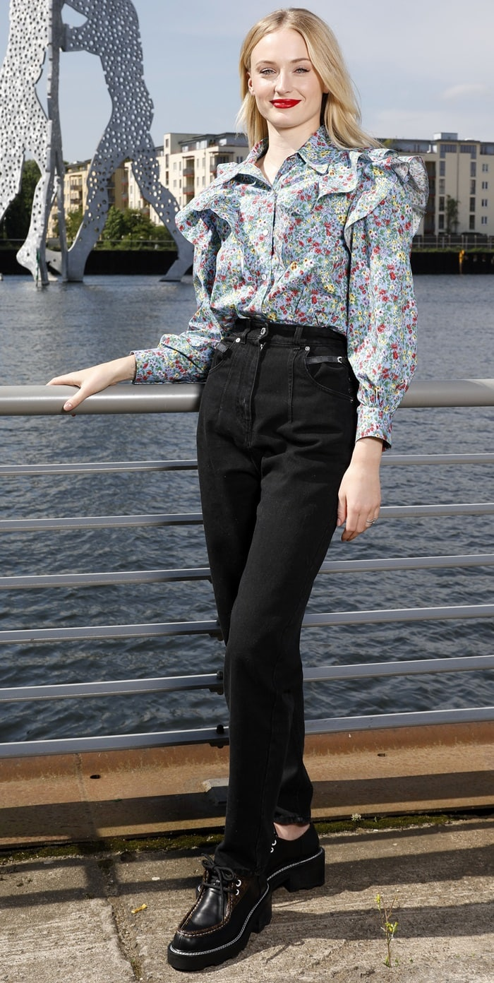 Sophie Turner wears chunky black boots for a photocall for X-Men: Dark Phoenix in Berlin