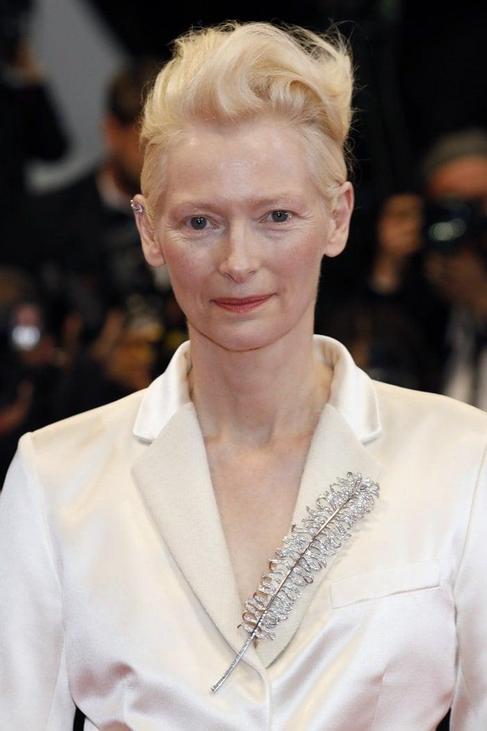 Tilda Swinton's ill-fitting cream satin suit and feather brooch