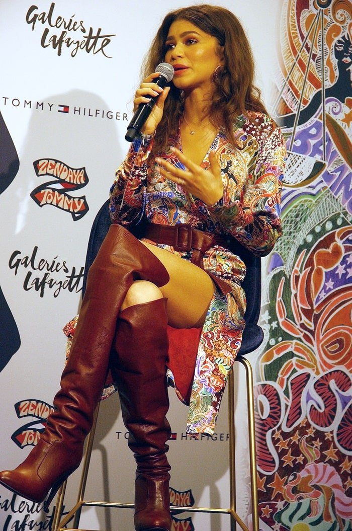 Zendaya poses for photos while attending a photo call for the Tommy x Zendaya fashion collection