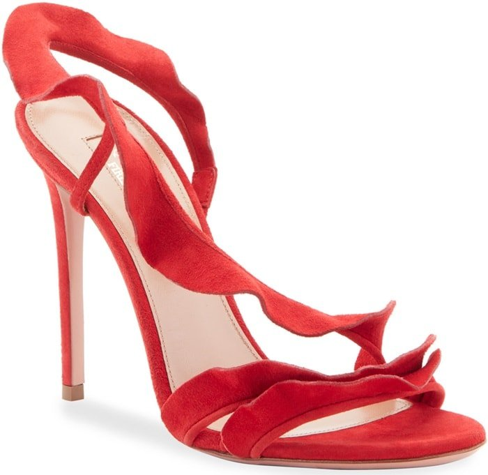 Made in Italy from buttery suede in vivid lipstick red, the strappy style features a flirty ruffle that cascades up the foot and wraps around the ankle