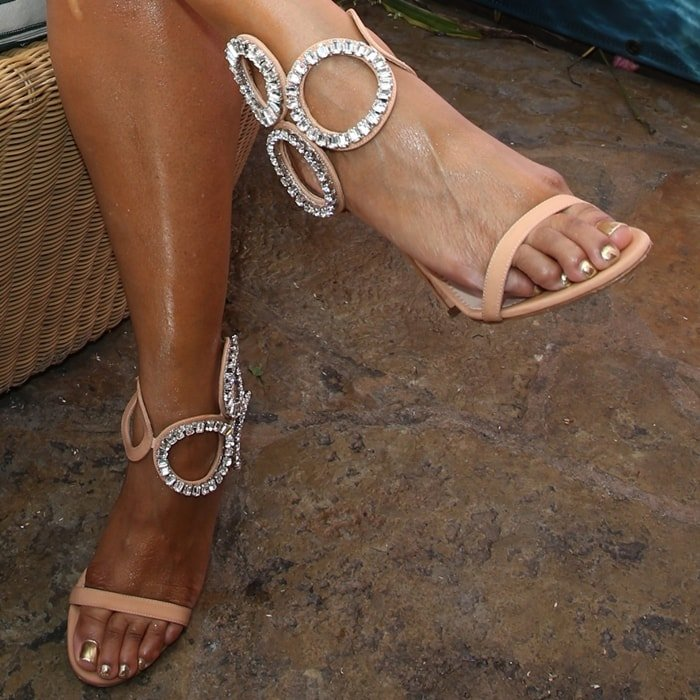 Ashanti shows off her feet in candy pink silk sandals