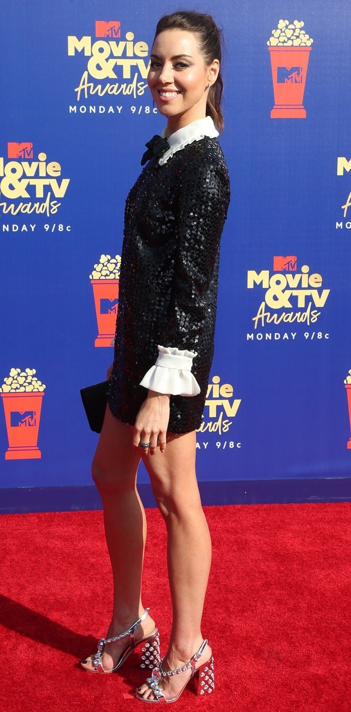 Aubrey Plaza flaunted her legs in a black sequinned mini dress