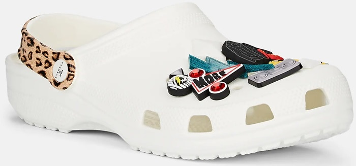 These rubber clogs are embellished with multicolored assorted rubber pyramid spikes and pop culture-inspired charms