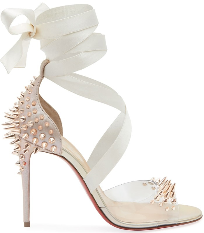 The insole is crafted in leather and a grosgrain ribbon embellishment crosses over the vamp and wraps around the ankle