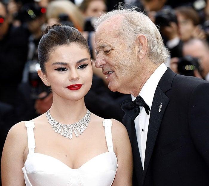 Bill Murray whispering in Selena Gomez's ear