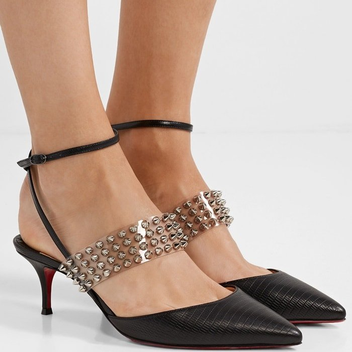 An of-the-moment translucent strap punctuated with gleaming conical studs brings edgy style to a pointy-toe pump topped with a svelte wraparound ankle strap