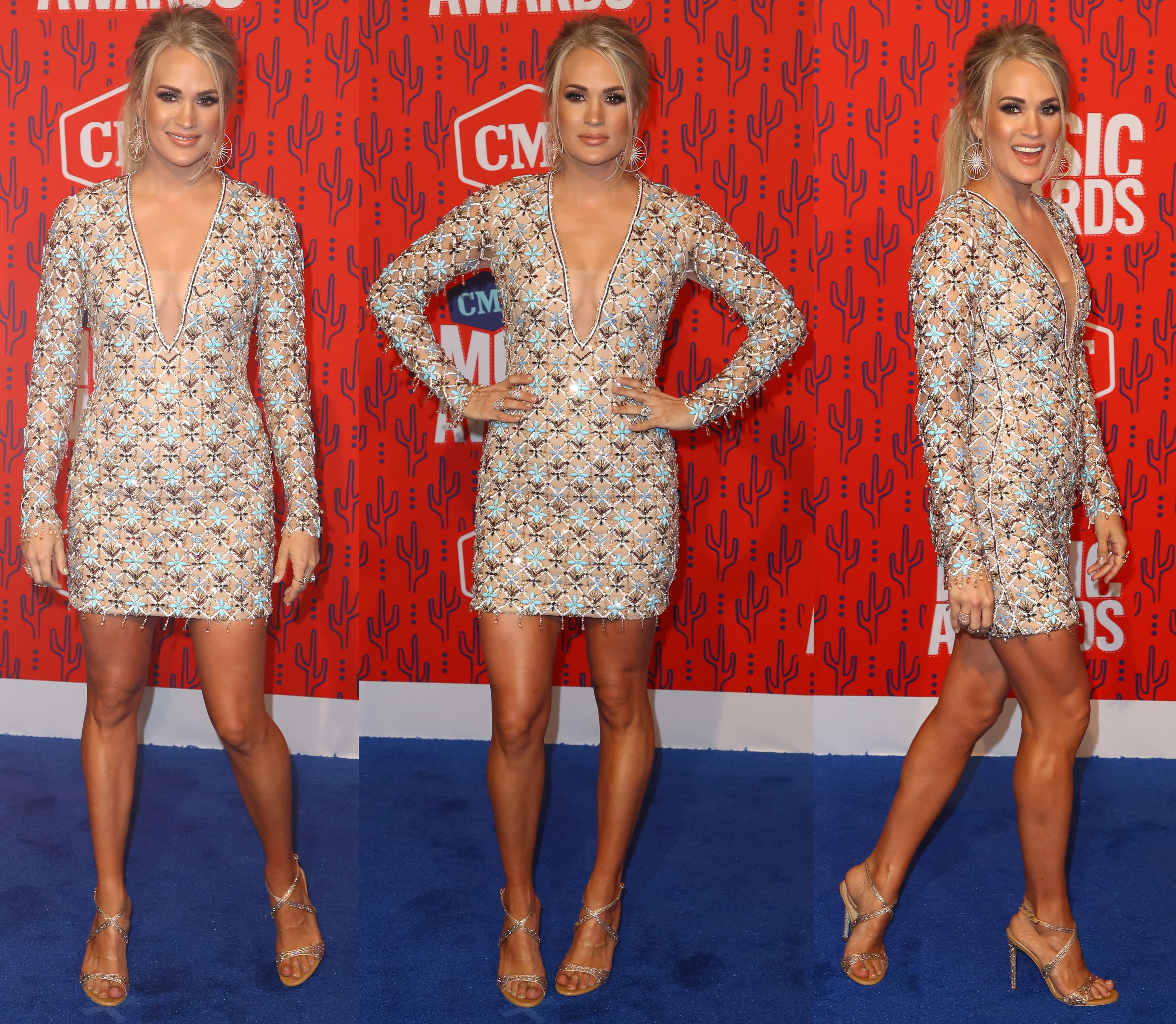 Carrie Underwood flashes her sexy legs in a yellow, embellished mini from Michael Cinco
