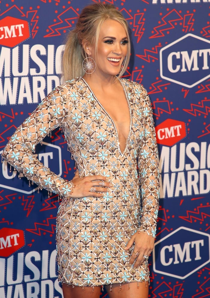 Carrie Underwood put her perfect legs on display yet again in a yellow embellished Michael Cinco creation